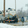 Joed Viera/Staff Photographer-Lockport ,NY-A man waits for a train to cross an icy Niagara Street.