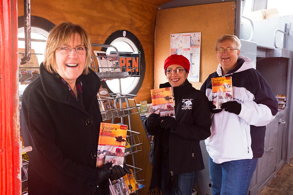 "Joed Viera/Staff Photographer-Olcott ,NY-Newfane 365 organizers Ann Schulze, Gina Guido-Redden and Barb Miller stop by the visitors center located inside their ""Caboose""."