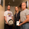 Joed Viera/Staff Photographer-Laurie Pinzel stands between   Joe and John Pinzel as they hold the faulty vent cap and the noisy carbon monoxide alarm.