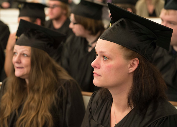Joed Viera/Staff Photographer-Lockport, NY-Ronesue Chase sits next to an emotional Tina Netzel during a BOCES graduation ceremony at Christ Community Church . The pair received their High School Equivalency Diplomas along with close to 30 other students on Thursday Night.