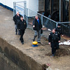 Joed Viera/Staff Photographer-Police arrive to check a call of a possible skull in the canal.