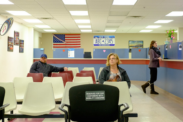 Joed Viera/Staff Photographer-Customers wait at the Niagara County DMV on Market Street. County Clerks across New York State are dealing with the economic impact of increasing online transations.