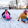 Joed Viera/Staff Photographer- Lockport, NY-Rebecca, Britton, 6, and Shamus Brady sled at Lockport Town and Country Club.