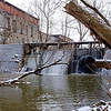 Joed Viera/Staff Photographer- Lockport, NY-Eighteen Mile Creek flows behind 62 Mill Street. The EPA's clean-up phase involves removing PCBs, lead and other contaminents from the creek.