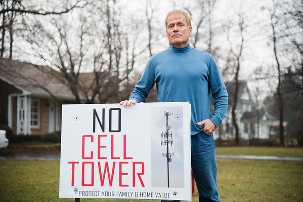 Joed Viera/Staff Photographer-Lockport ,NY-David Marotta, a local resident and developer  stands in his front yard in the 7100 block of Chestnut Ridge Road. Marotta is protesting the installation of a cell tower stating it will reduce property values in his neighborhood and claiming it could be a public health risk.