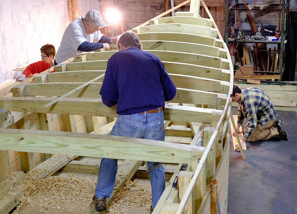 Joed Viera/Staff Photographer- Buffalo, NY-Clockwise from left: Carol Schmidt, Skip Hauenstein, Tim Kukulka and Kent Iggulden work on a Durham style boat at the Buffalo Maritime Center. When finished the boat will be placed into the Flight of Five.