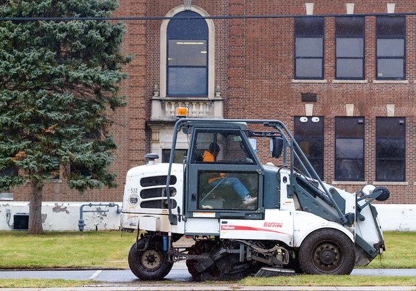 Joed Viera/Staff Photographer-City street sweepers take advantage of Thursday's weather to clean up Rogers Avenue.
