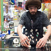 Joed Viera/Staff Photographer-Kyle Melancon organizes jewlery he made at his shop Earth House.