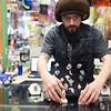 Joed Viera/Staff Photographer-Kyle Melancon organizes jewlery he made at his shop Earth House.