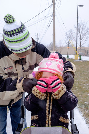 Joed Viera/Staff Photographer-Justin and Isabella Sheehan take a stroll down Shimer Drive through the snow.
