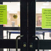 Joed Viera/Staff Photographer-Lockport, NY-Signs posted on the Gymnasium entrance to Lockport High School inform visitors of the cancellation of Thursday night's basketball game.