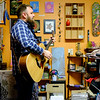 "Joed Viera/Staff Photgrapher-Earth House's featured musician Josh Cogovan sings his original tune ""Libations"" at  the shop on Wendesday."