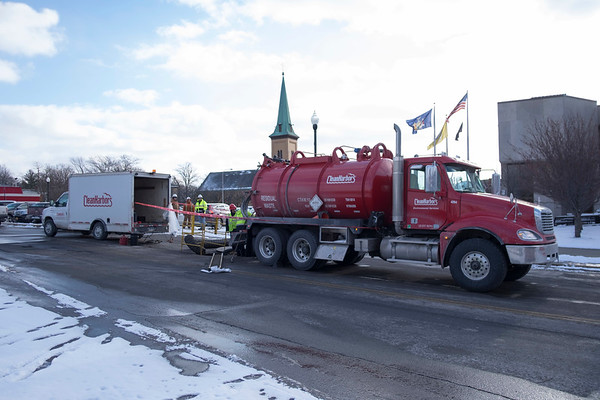 JOED VIERA/STAFF PHOTOGRAPHER-Lockport, NY-Workers pump out waste from the sewer on Cottage Street.