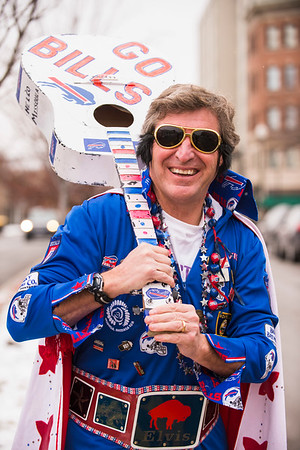 """Joed Viera/Staff Photographer- Lockport, NY-John """"Bills Elvis"""" Lang holds his guitar on Main Street. Lang has dressed as the King at Buffalo Bills games for close to 25 years"""