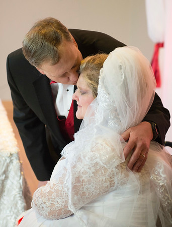 JOED VIERA/STAFF PHOTOGRAPHER- Lockport, NY-Allison Mawhinney and Mark Kifner embrace after their marraige ceremony at Mountview Assisted Living Facility. The pair met at Newfane rehab facility while they were recovering from health problems. Mark proposed to Allison last June and they decided on a Valentines Day wedding to make it special.