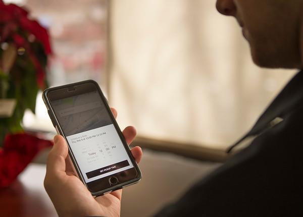 Joed Viera/Staff Photographer- Lockport, NY-Lockport reporter Tim Fenster pulls Uber's app up on his phone.