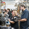 JOED VIERA/STAFF PHOTOGRAPHER- Lockport, NY-UAW local 686 chairman Mike Branch reads a manual before assembling an HVAC unit for team 824.