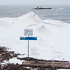 A no swimming sign stands as snow falls along the shores of Lake Ontario at Olcott Beach on Wednesday, Feb. 15, 2017 in Olcott, N.Y.  Hopes are the beach stays icy through next week for the annual Polar Bear Swim on Feb. 26(Joed Viera/Lockport Union-Sun & Journal)