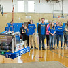 JOED VIERA/STAFF PHOTOGRAPHER-Lockport, NY-Lockport High School Warlocks watch as their robot climbs a rope during a demonstration in the school gym.