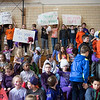 JOED VIERA/STAFF PHOTOGRAPHER-Newfane, NY-Newfane Middle Schoolers hold up signs before their classmates get their heads shaved for Roswell Park's Bald for Bucks Event.