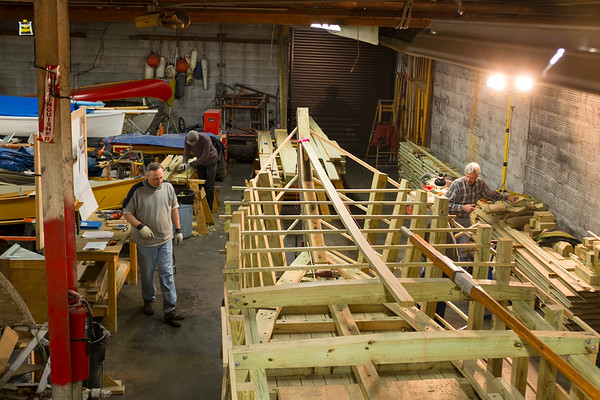"Volunteer boat-builders work on the ""Erie Traveler"" at the Buffalo Maritime Center in Buffalo, N.Y. on January, 31st 2017. The Traveler is a Durham-style boat that is being constructed by 30 volunteers at the  Center. When finished, the boat will be placed in the water at Lockport, N.Y.'s Flight of Five, to demonstrate how the old locks worked. (Joed Viera/Lockport Union-Sun & Journal)"