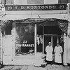 Lockport, NY-Monando's storefront on 23 Main Street is shown in an late 1910's photograph.