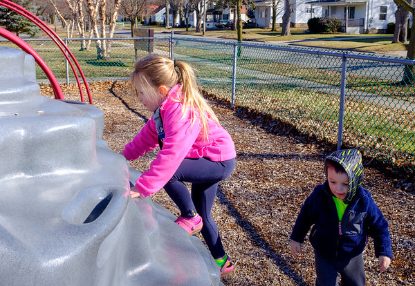 JOED VIERA/STAFF PHOTOGRAPHER-Lockport, NY-Makayla Klumpp, 4, and her cousin Jack Sheehan, 3, play at Altro Park.