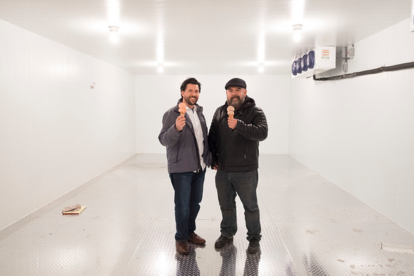 JOED VIERA/STAFF PHOTOGRAPHER-Lockport, NY-Lake Effect Ice Cream owners Erik Bernardi and Jason Wulf hold cones in the new freezer of their new production facility on Niagara Street.