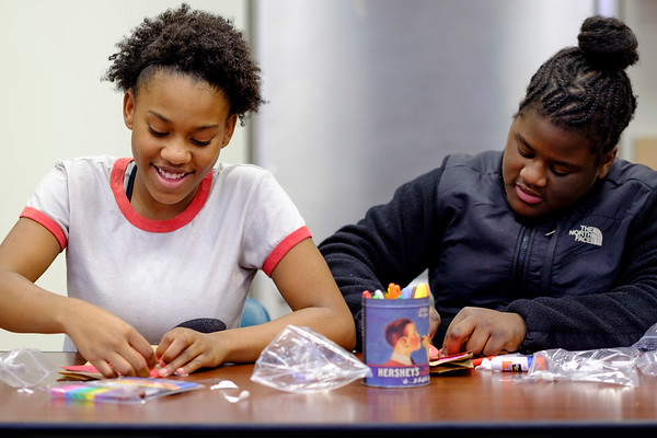 JOED VIERA/STAFF PHOTOGRAPHER-Lockport, NY-Jordan Chandler, 13, and Carmella Hill, 12, make Valentine's Day gift bags for residents of Presbyterian Home after school at the Salvation Army.
