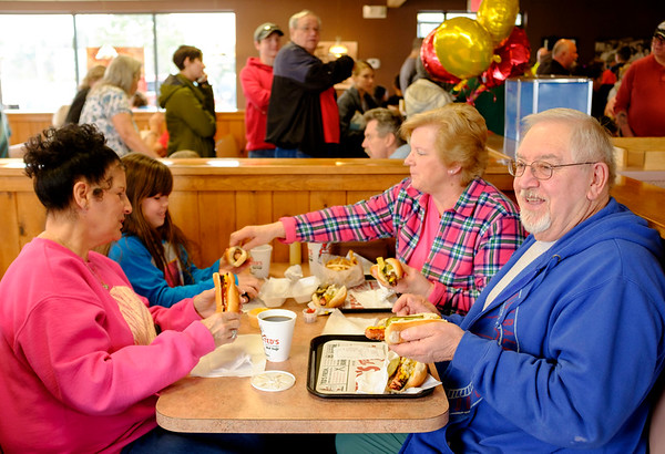 JOED VIERA/STAFF PHOTOGRAPHER-Lockport, NY-Diane Hieman, Rielly Haenly 7, Debbie Bielak and Tony Bielak enjoy some frankfurters at Ted's on Shimer Road during their customer appreciation day. Ted's sold hot dogs for 90 cents on Wednesday to celebrate 90 years of operation.