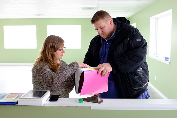 Joed Viera/Staff Photographer- Pendleton, NY- Owners  Jennifer and Jacob Wankasky sort through papers while preparing to open 5 Corners Country Store & Antiques. The store's grand opening is on Feburary 25th.