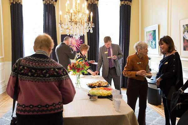 Joed Viera/Staff Photographer- Lockport, NY-Attendees  enjoy a spread after the Kenan Center's event.