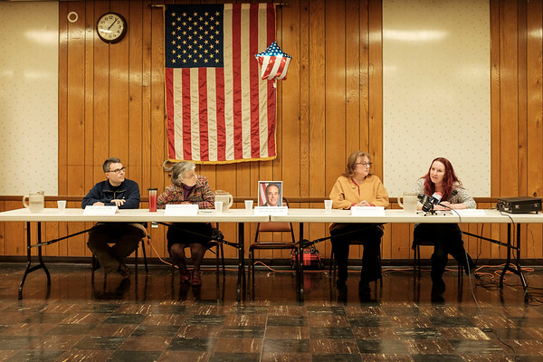 JOED VIERA/STAFF PHOTOGRAPHER-Lockport, NY-Dozens showed up to listen to panelists Kyle Lambalzer, RN, Dr Margaret Libby, small business owner Diana Kastenbaum and Kimberly Kornowski, RN at the Town Hall style meeting held by the 1199SEIU at the American Legion on Niagara Street.