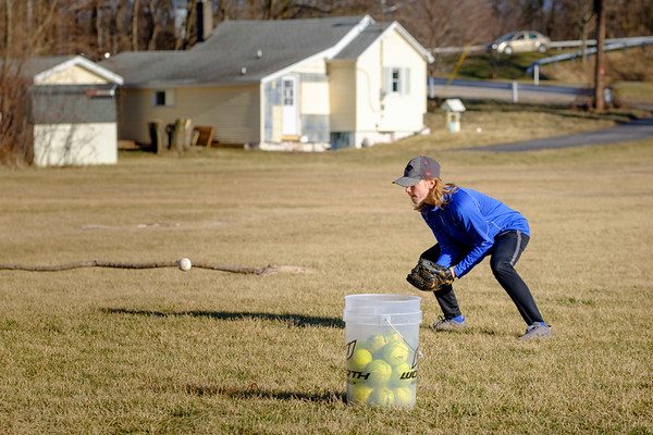 JOED VIERA/STAFF PHOTOGRAPHER-Lockport, NY-Tyler Sansone, 15, anticipates a catch while practicing with his cousins at Dolan Park.