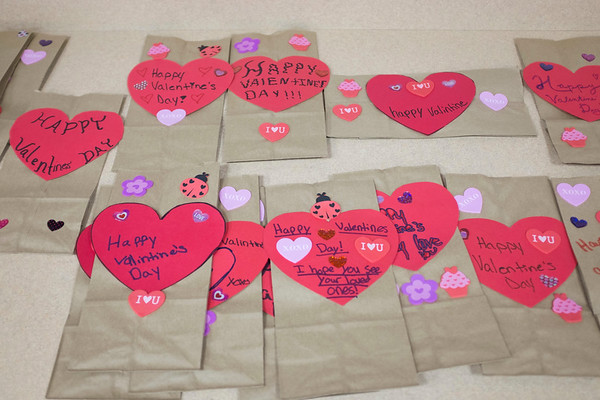 JOED VIERA/STAFF PHOTOGRAPHER-Lockport, NY-Valentine's Day gift bags at the Salvation Army made for residents of Presbyterian Home by participants in the Salvation Army's after school program.