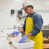 Joed Viera/Staff Photographer- Lockport, NY-Todd Thorman sorts through Monando's wholesale customer's haddock shipments behind the fishmonger's offices on East Ave.