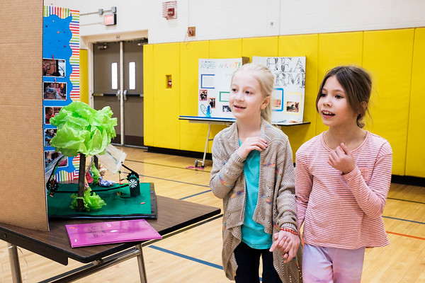 JOED VIERA/STAFF PHOTOGRAPHER- Pendleton, NY-Douglas Regan Elementary 3rd-graders Adelaide Najuch, 8 and Jordyn Davila, 9, browse the entries of Starpoint's Inventathon in the School's gym.