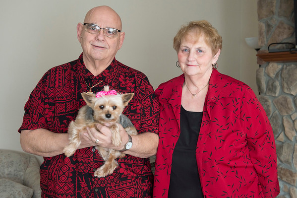Joed Viera/Staff Photographer- Lockport, NY- Larry and Allie Morrow with thier dog Baby Girl. The Morrows have been married for 20 years and met through a US&J ad. The couple will be renewing their vows at Woodlands Community Center on Valentine's day.