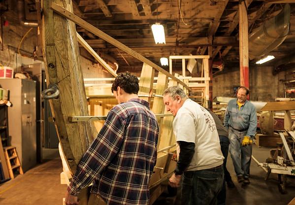Joed Viera/Staff Photographer-Buffalo, NY-Tim Kukulka, Skip Hauenstein and Tom Glynn work on the Erie Traveler Thursday at the Buffalo Maritime Center.