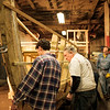 Joed Viera/Staff Photographer-Buffalo, NY-Tim Kukulka, Skip Hauenstein and Tom Glynn work on the Erie Traveler Thursday at the Buffalo Maritime Center.