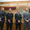 Joed Viera/Staff Photographer- Lockport, NY- Richard Gowanlock, Joshua Wolck, Adam Turton and Timothy Lundquist before being sworn in as the City's new firefighters during a ceremony in the City Council Chamber.