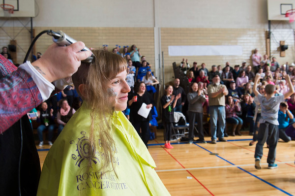 JOED VIERA/STAFF PHOTOGRAPHER-Newfane, NY-Newfane Middle School 7th grader Shelby Nerber gets her head shaved for Roswell Park's Bald for Bucks event as Tim Birdsall celebrates his shaved head.