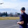Joed Viera/Staff Photographer-Lockport, NY-Eric Farrell takes advantage of Friday's weather to fly his RC plane outside of Lockport High School.