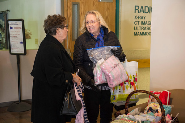 Joed Viera/Staff Photographer- Lockport, NY-Zonta'a Lorraine Sparks and Donna Kleinhans hold  newborn baby supplies in the ENH lobby before delivering newborn baby supplies to ENH OB manager Becky Kucharczak.