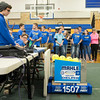 JOED VIERA/STAFF PHOTOGRAPHER-Lockport, NY-Lockport High School junior, Andrew Pencille, 16, controls the Warlocks' robot during a demonstration in the school gym.