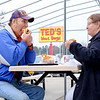 JOED VIERA/STAFF PHOTOGRAPHER-Lockport, NY-Tim and Patricia O'Connor enjoy some onion rings, frankfurters and a 60 degree day at Ted's on Shimer Road during their customer appreciation day.  Ted's sold hot dogs for 90 cents on Wednesday to celebrate 90 years of operation.