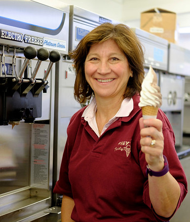 JOED VIERA/STAFF PHOTOGRAPHER-Lockport, NY-Tasty Treat owner Nanette Frey holds up a twist cone after testing the custard machine at shop on Thursday. The ice cream stand is set to open for its 17th season on March 2nd.