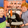 "JOED VIERA/STAFF PHOTOGRAPHER- Pendleton, NY-Douglas Regan Elementary 3rd-graders  Carter Wohlleber, 9 and Logan Schwock, 9, show off their entry for Starpoint's Inventathon ""A Baby's Dream"". Their invention is attached to car seats to keep babies warm."