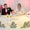 JOED VIERA/STAFF PHOTOGRAPHER- Lockport, NY-Allison Mawhinney and Mark Kifner cut their cake after their marraige ceremony at Mountview Assisted Living Facility. The pair met at Newfane rehab facility while they were recovering from health problems. Mark proposed to Allison last June and they decided on a Valentines Day wedding to make it special.