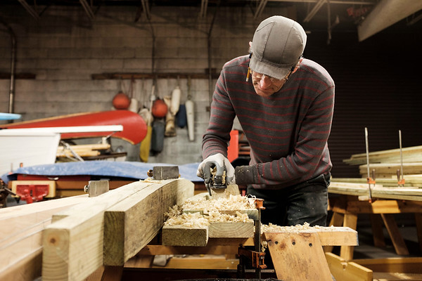 Work is continuing on the Durham-style boat that is being constructed by 30 volunteers at the Buffalo Maritime Center. When finished, the boat will be placed in the water at Lockport's Flight of Five, to demonstrate how the old locks worked. Here, volunteer boat-builder John Clauss planes the side of the boat on January, 31st 2017.(Joed Viera/Lockport Union-Sun & Journal)